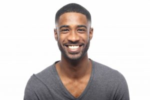 man smiling with healthy teeth
